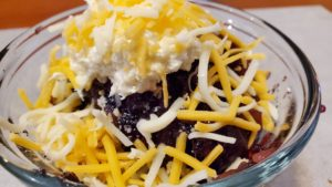 cherry cola jell-o salad with shredded cheese (adapted from the best of beta sigma phi cookbook, 1991)